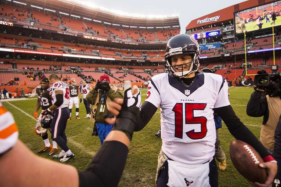Houston Texans quarterback Ryan Mallett clutches the game ball as he shakes hands with Cleveland Browns players after the Texans victory over the Browns at FirstEnergy Stadium on Sunday, Nov. 16, 2014, in Cleveland. ( Smiley N. Pool / Houston Chronicle ) Photo: Smiley N. Pool, Houston Chronicle