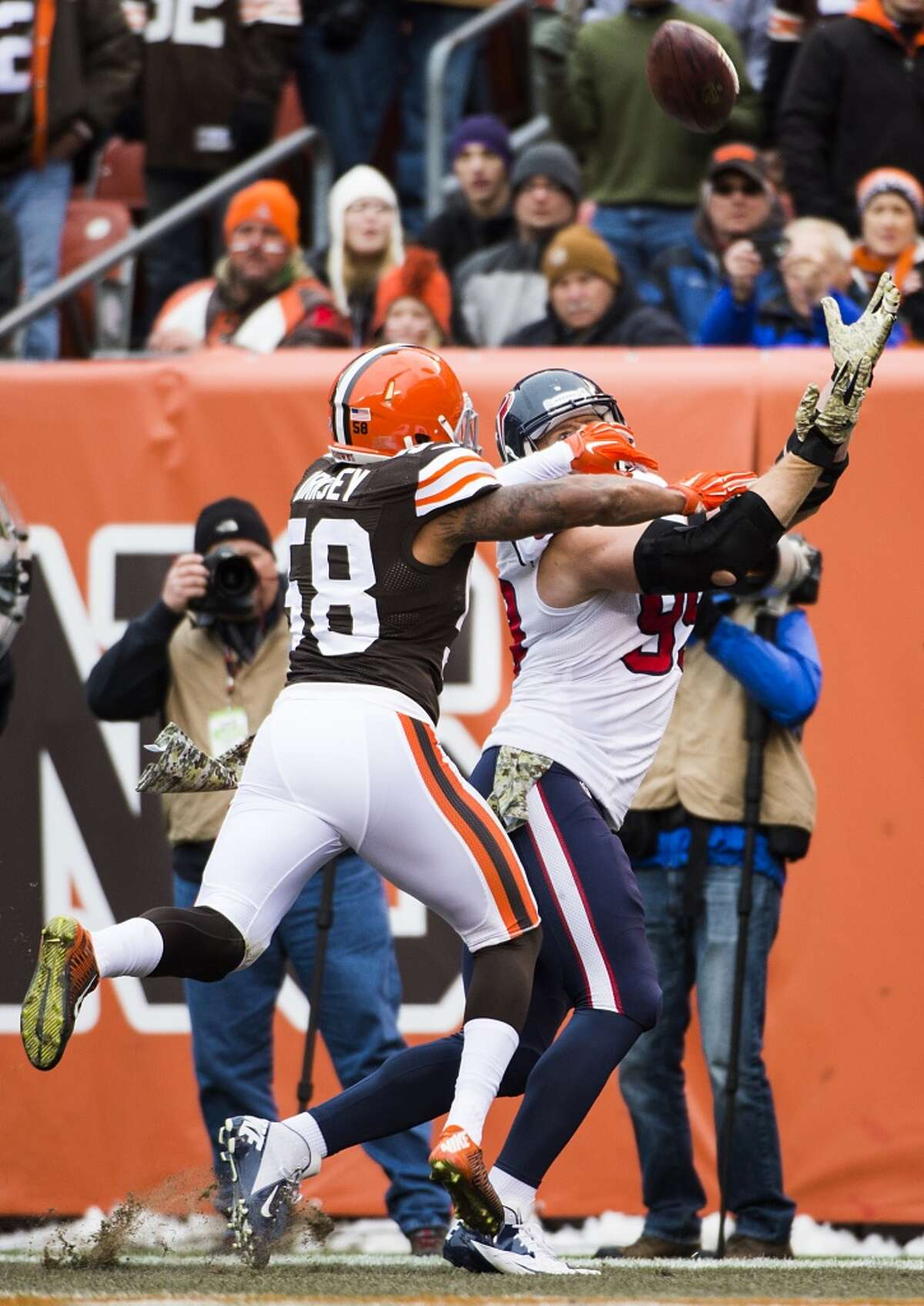 Houston Texans defensive end J.J. Watt (99) catches a touchdown pass despite the defense from Cleveland Browns inside linebacker Chris Kirksey (58) during the first quarter of NFL football game at FirstEnergy Stadium on Sunday, Nov. 16, 2014, in Cleveland. ( Smiley N. Pool / Houston Chronicle )