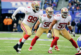 Aldon Smith (99), after serving a nine-game suspension, sat out the first quarter Sunday but then helped the 49ers keep the Giants' offense in check.