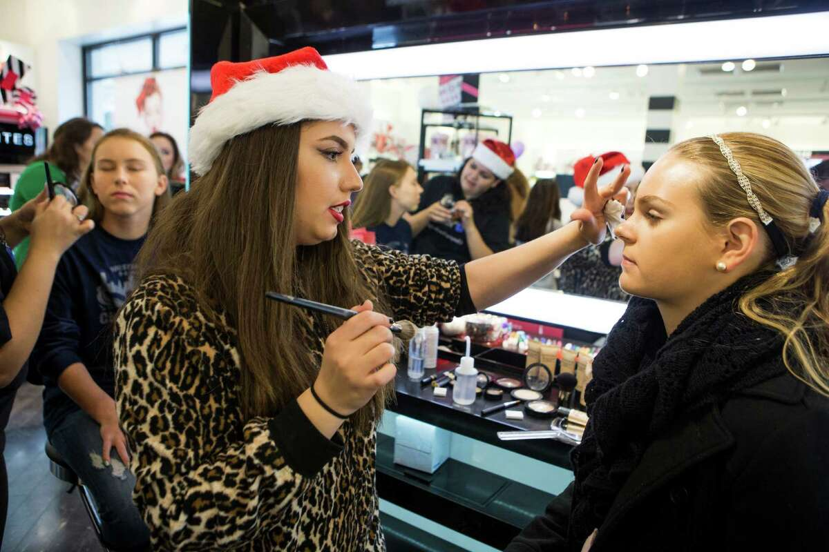 Layan Mezian, left, works on makeup for Haley May, 15, at Sephora in the Rice Village on Sunday, Nov. 16, 2014, in Houston. The Periwinkle Foundation and Sephora partnered together to bring a morning of pampering for girls who are affected by cancer and other life threatening illnesses. Girls and their best friends are showered with free samples and beauty tips.
