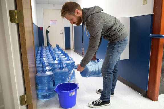 Operations Manager Matt Hansen says YES Prep North Central spends about $300 on bottled water every day the school's water goes out.