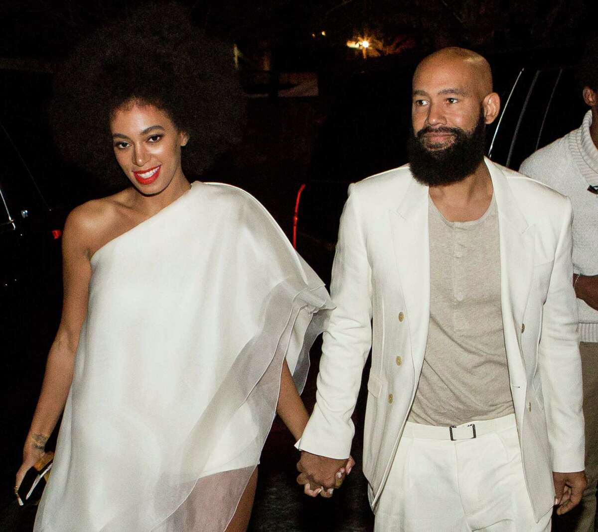 Musician Solange Knowles (wearing Stephane Rolland with Stuart Weitzman shoes and a Lee Savage clutch) and her fiancee, music video director Alan Ferguson (wearing Costume National with an H&M shirt and Maison Martin Margiela shoes), arrive for their rehearsal dinner at the Felicity Street Methodist Church on November 15, 2014 in New Orleans, Louisiana. (Photo by Josh Brasted/WireImage)AP story: Solange Knowles weds video director