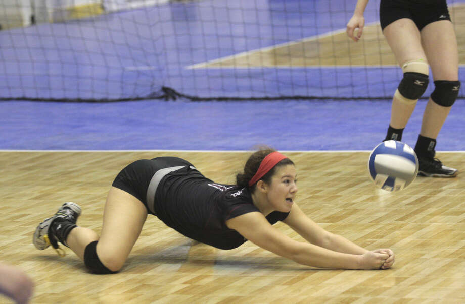 Burnt Hills-Ballston's Natalie Schurman dives for a dig during the NYSPHSAA Class A volleyball finals versus Pittsford Sutherland Sunday at the Glens Falls Civic Center. Burnt Hills lost three sets to two in the five set match. Ed Burke photo 11/16/14 Photo: Ed Burke / 00029512A