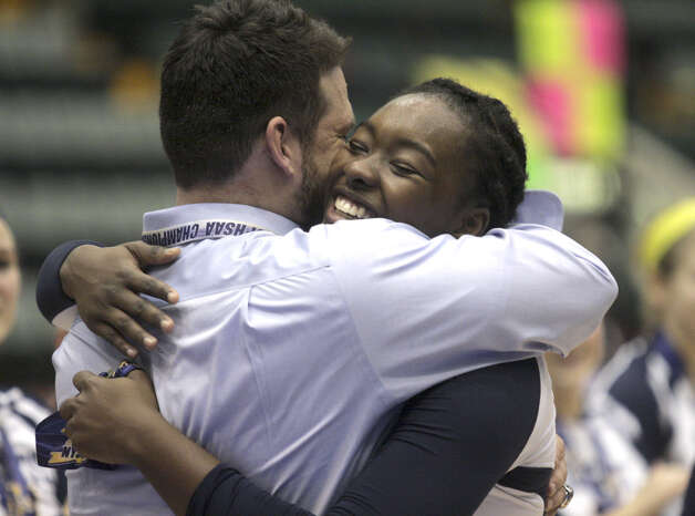 Pittsford Sutherland's Santita Ebangwese embraces coach Matt Glover after  the NYSPHSAA Class A volleyball finals Sunday Nov. 16, 2014, at Glens Falls Civic Center. Burnt Hills lost three sets to two in the five set match. Ed Burke/Special to the Times Union) Photo: Ed Burke / 00029512A