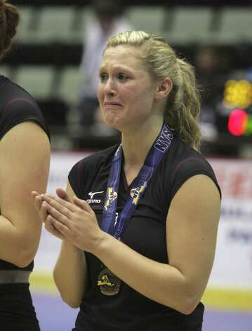 Applauding the victors, Burnt Hills-Ballston's Jessica Dillon is overcome with emotion after the Spartans lost to Pittsford Sutherland during the NYSPHSAA Class A volleyball finals Sunday Nov. 16, 2014, at Glens Falls Civic Center. Burnt Hills lost three sets to two in the five set match. Ed Burke/Special to the Times Union) Photo: Ed Burke / 00029512A