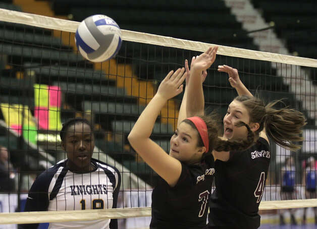 Burnt Hills-Ballston Lake's  Natalie Schurman (7) and Natalie Albright watch a spike by Pittsford Sutherland's Santita Ebangwese sail by during the NYSPHSAA Class A volleyball finals Sunday Nov. 16, 2014, at Glens Falls Civic Center. Burnt Hills lost three sets to two in the five set match. Ed Burke/Special to the Times Union) Photo: Ed Burke / 00029512A