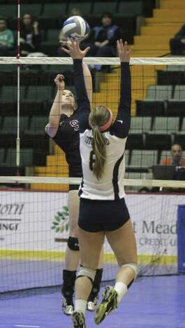 Burnt Hills-Ballston Lake's Meghan Keyes hits into defense by Pittsford Sutherlands's Sarah Blowers during the NYSPHSAA Class A volleyball finals Sunday Nov. 16, 2014, at Glens Falls Civic Center. Burnt Hills lost three sets to two in the five set match. Ed Burke/Special to the Times Union) Photo: Ed Burke / 00029512A