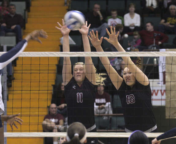 Burnt Hills-Ballston Lake's Jessica Dillon (11) and Kelly Waters can't stop a hit by Pittsford Sutherland's Santita Ebangwese during the NYSPHSAA Class A volleyball finals Sunday Nov. 16, 2014, at Glens Falls Civic Center. Burnt Hills lost three sets to two in the five set match. Ed Burke/Special to the Times Union) Photo: Ed Burke / 00029512A