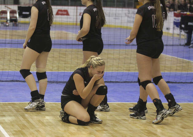 Burnt Hills-Ballston's Jessica Dillon is overcome with emotion after the Spartans lost to Pittsford Sutherland during the NYSPHSAA Class A volleyball finals Sunday Nov. 16, 2014, at Glens Falls Civic Center. Burnt Hills lost three sets to two in the five set match. Ed Burke/Special to the Times Union) Photo: Ed Burke / 00029512A