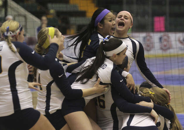 Pittsford Sutherland players celebrates their victory during the NYSPHSAA Class A volleyball finals Sunday Nov. 16, 2014, at Glens Falls Civic Center. Burnt Hills lost three sets to two in the five set match. Ed Burke/Special to the Times Union) Photo: Ed Burke / 00029512A