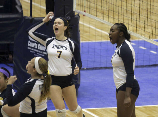 Pittsford Sutherland's Santita Ebangwese, right, celebrates with teammates after her kill during the NYSPHSAA Class A volleyball finals Sunday Nov. 16, 2014, at Glens Falls Civic Center. Burnt Hills lost three sets to two in the five set match. Ed Burke/Special to the Times Union) Photo: Ed Burke / 00029512A