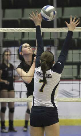 Burnt Hills-Ballston Lake's Meghan Keyes hits into defense by Pittsford Sutherland's Taylor Kells during the NYSPHSAA Class A volleyball finals Sunday Nov. 16, 2014, at Glens Falls Civic Center. Burnt Hills lost three sets to two in the five set match. Ed Burke/Special to the Times Union) Photo: Ed Burke / 00029512A