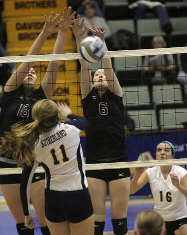 Burnt Hills-Ballston Lake's Kelly Waters (18) and Emma Spotbery block a shot by Pittsford Sutherland's Ann Bisogano during the NYSPHSAA Class A volleyball finals Sunday Nov. 16, 2014, at Glens Falls Civic Center. Burnt Hills lost three sets to two in the five set match. Ed Burke/Special to the Times Union) Photo: Ed Burke / 00029512A