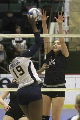 Burnt Hills-Ballston Lake's Kelly Waters goes up to block a hit by Pittsford Sutherland's Santita Ebangwese during the NYSPHSAA Class A volleyball finals Sunday Nov. 16, 2014, at Glens Falls Civic Center. Burnt Hills lost three sets to two in the five set match. Ed Burke/Special to the Times Union) Photo: Ed Burke / 00029512A
