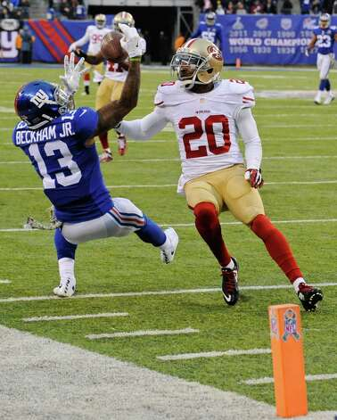 New York Giants wide receiver Odell Beckham (13) catches a pass in front of San Francisco 49ers' Perrish Cox (20) during the second half of an NFL football game Sunday, Nov. 16, 2014, in East Rutherford, N.J. The 49ers won the game 16-10. (AP Photo/Bill Kostroun) ORG XMIT: ERU139 Photo: Bill Kostroun / FR51951 AP
