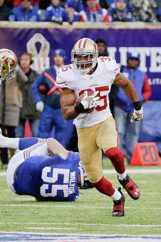 San Francisco 49ers free safety Eric Reid (35) runs back an interception during the second half of an NFL football game against the New York Giants Sunday, Nov. 16, 2014, in East Rutherford, N.J.  (AP Photo/Julio Cortez) ORG XMIT: ERU125 Photo: Julio Cortez / AP