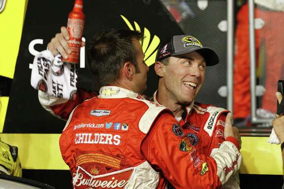 Kevin Harvick, right, and team owner Tony Stewart revel in Harvick's first championship.