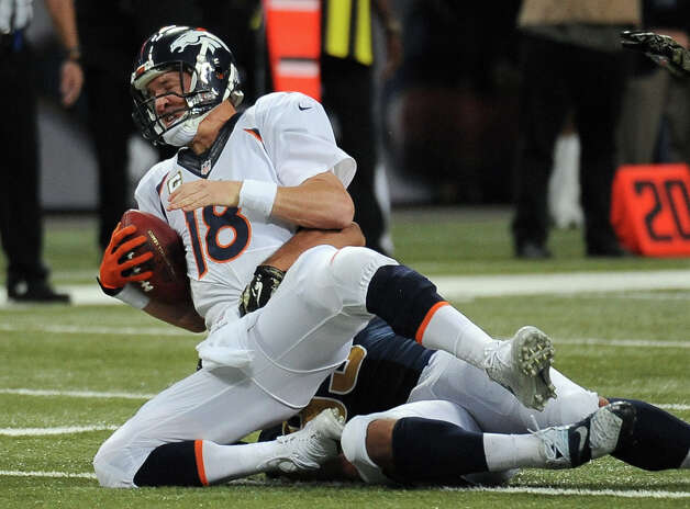 Denver Broncos quarterback Peyton Manning, left, is sacked for a 12-yard loss by St. Louis Rams defensive tackle Aaron Donald during the fourth quarter of an NFL football game Sunday, Nov. 16, 2014, in St. Louis. The Rams' Robert Quinn also received half credit for the sack. (AP Photo/L.G. Patterson) ORG XMIT: MOJR124 Photo: L.G. Patterson / FR23535 AP