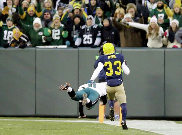 Green Bay Packers' Micah Hyde gets past Philadelphia Eagles punter Donnie Jones (8) as he runs back a punt 75 yards for a touchdown during the first half of an NFL football game Sunday, Nov. 16, 2014, in Green Bay, Wis.  (AP Photo/Tom Lynn)  ORG XMIT: WIMG122 Photo: Tom Lynn / FR170717 AP