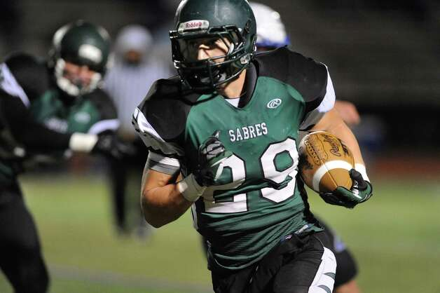 Schalmont's Kyle Strube, right, carries the ball during their Class B state quarterfinal football game against Peru on Friday, Nov. 14, 2014, at Shenendehowa High in Clifton Park, N.Y. (Cindy Schultz / Times Union) Photo: Cindy Schultz / 00029471A
