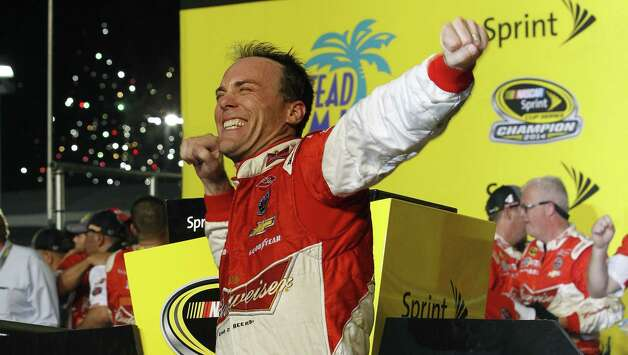 Kevin Harvick celebrates winning the NASCAR Sprint Cup championship series auto race, Sunday, Nov. 16, 2014 in Homestead, Fla. (AP Photo/Terry Renna) ORG XMIT: FLJC147 Photo: Terry Renna / FR60642