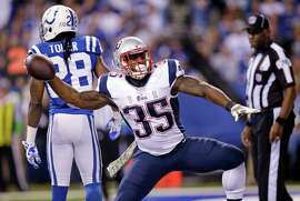 New England Patriots running back Jonas Gray celebrates after scoring a touchdown against the Indianapolis Colts during the first half of an NFL football game in Indianapolis, Sunday, Nov. 16, 2014.