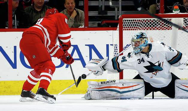 Carolina Hurricanes' Jeff Skinner (53) has his shot blocked by San Jose Sharks goalie Troy Grosenick (34) during the first period of an NHL hockey game in Raleigh, N.C., Sunday, Nov. 16, 2014. Grosenick faced 45 shots in the Sharks 2-0 shut out. (AP Photo/Karl B DeBlaker) ORG XMIT: NCKD107 Photo: Karl B DeBlaker / FR7226 AP