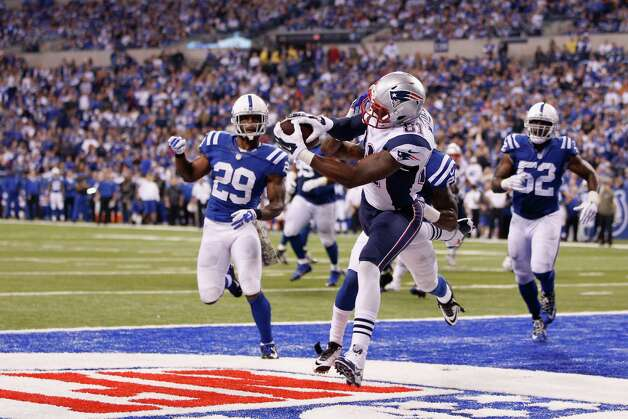 INDIANAPOLIS, IN - NOVEMBER 16:  Timothy Wright #81 of the New England Patriots scores a touchdown against  Greg Toler #28 of the Indianapolis Colts during the third quarter of the game at Lucas Oil Stadium on November 16, 2014 in Indianapolis, Indiana.  (Photo by Joe Robbins/Getty Images) ORG XMIT: 507864495 Photo: Joe Robbins / 2014 Getty Images