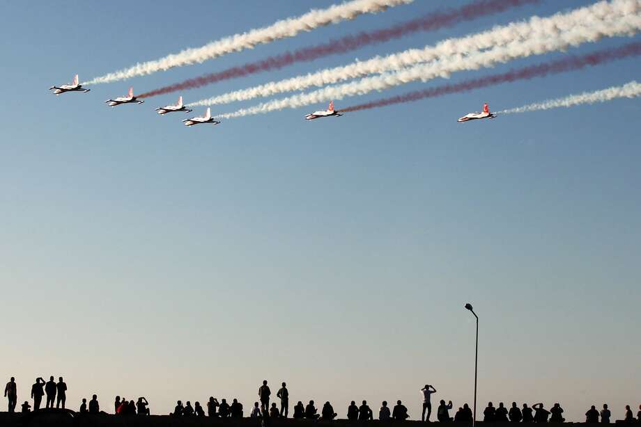 """TOPSHOTS The Turkish Air Force, Turkish Stars aerobatic demonstration team, perform during celebrations of the 31st anniversary of proclamation of the Turkish Republic of Northern Cyprus (TRNC) on November 16,2014, in the Turkish occupied north of the Eastern Mediterranean Island in Kyrenia . The TRNC is not recognised internationally, except by Turkey. Cypriot President Nicos Anastasiades accused Turkey of """"provocative actions"""" that he said are hindering the island's peace talks and compromising security in the eastern Mediterranean. AFP PHOTO/ Yiannis KourtoglouYiannis Kourtoglou/AFP/Getty Images Photo: Yiannis Kourtoglou, AFP/Getty Images"""