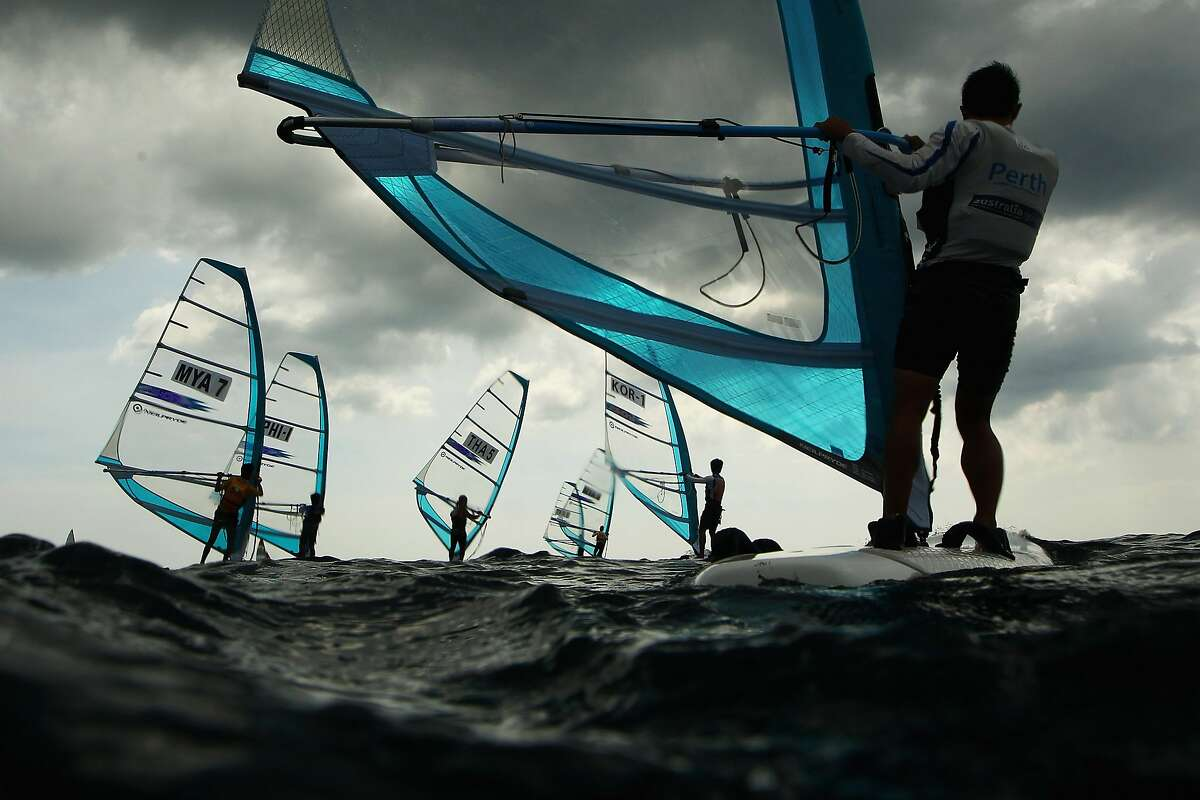 PHUKET, THAILAND - NOVEMBER 16: Competitors race in the Men's RS-One Windsurfing class during the 2014 Asian Beach Games at Karon Beach on November 16, 2014 in Phuket, Thailand. (Photo by Cameron Spencer/Getty Images) *** BESTPIX ***