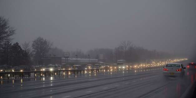 By 7:15 a.m. motorists were already facing a slow commute on Monday. Here, traffic in Clifton Park backs up on the southbound side of the Northway. Overnight snow was giving way to rain by morning, leaving roads sloppy. (Skip Dickstein / Times Union)