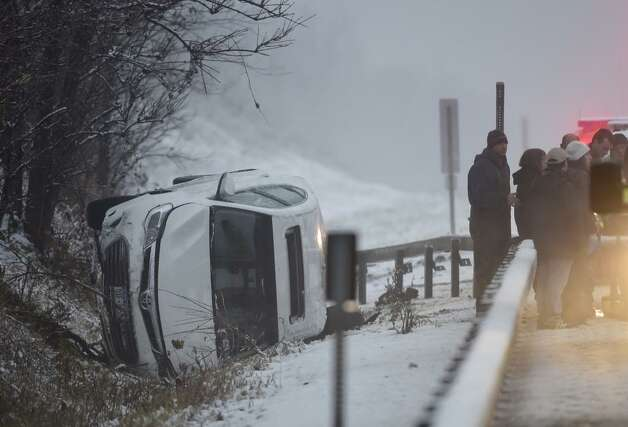 One of several vehicles that slid off the Northway on Monday. This one was on the northbound side of the highway just south of the city of Saratoga Springs. (Skip Dickstein / Times Union)
