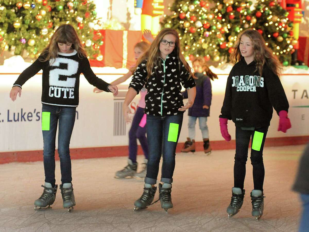 Bailey Leazitt, McKenna Bayless, and Brianna Leazitt, all of The Woodlands, chat as they enjoy their skating during The Ice Rink in The Woodlands preview weekend skating. The Ice Rink is located at the northeast corner of Lake Robbins and Six Pines Drive.