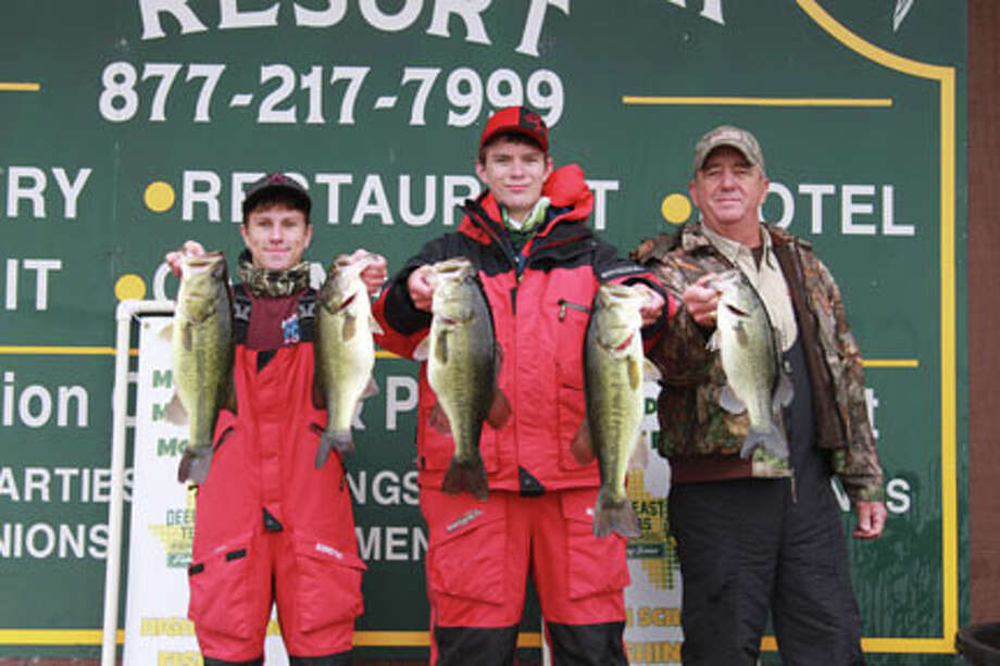 Robby Clark and Cory Hyden from Spurger High School show off their winning catch with boat captain Rusty West.  photo Carla Moorhead