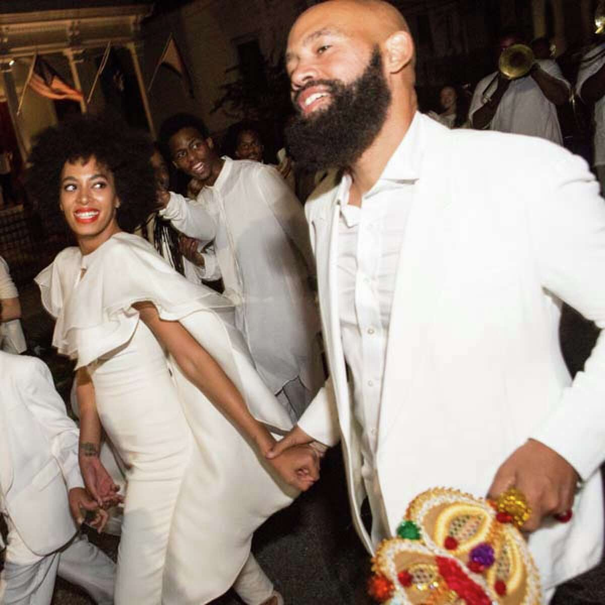 Musician Solange Knowles (L) and her new husband, music video director Alan Ferguson, attend the secondline with family and friends following their wedding on November 16, 2014 in New Orleans, Louisiana. (Photo by Josh Brasted/WireImage)