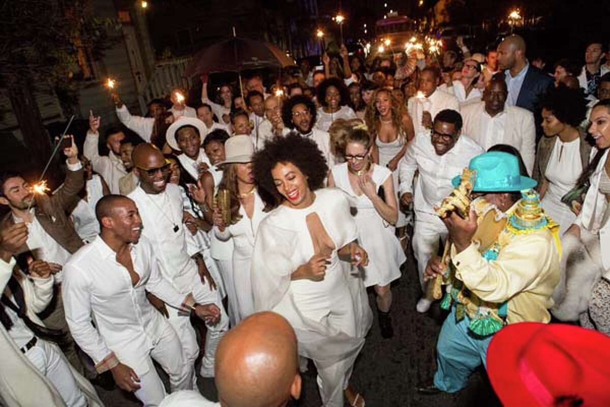 Musician Solange Knowles (C) and her new husband, music video director Alan Ferguson second line in the streets of New Orleans with family and guests after her wedding on November 16, 2014 in New Orleans, Louisiana. (Photo by Josh Brasted/WireImage)