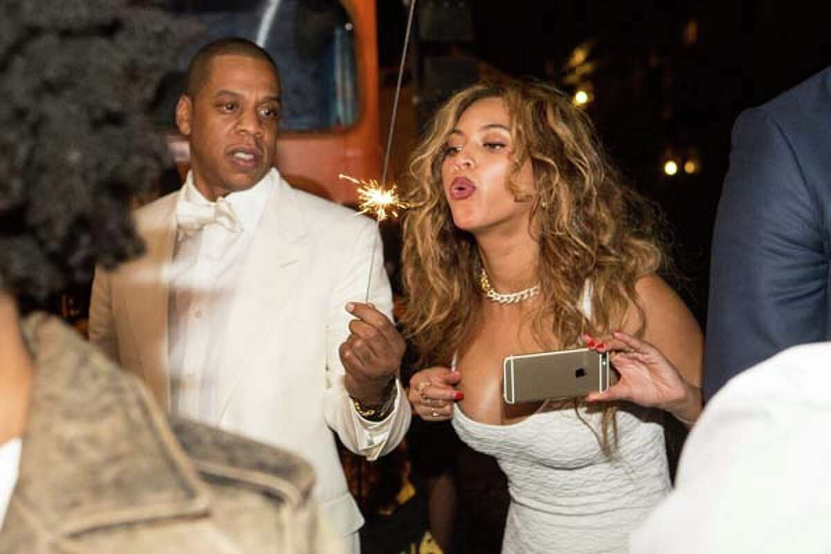 Jay Z (L) and Beyonce Knowles attend the secondline following sister Solange Knowles and her new husband, music video director Alan Ferguson's wedding on the streets of New Orleans on November 16, 2014 in New Orleans, Louisiana. (Photo by Josh Brasted/WireImage)