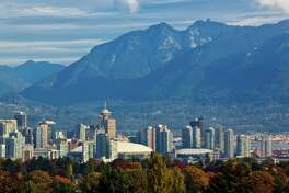A view of the Vancouver skylne and the North Shore Mountains in autumn.Vancouver British Columbia Canada