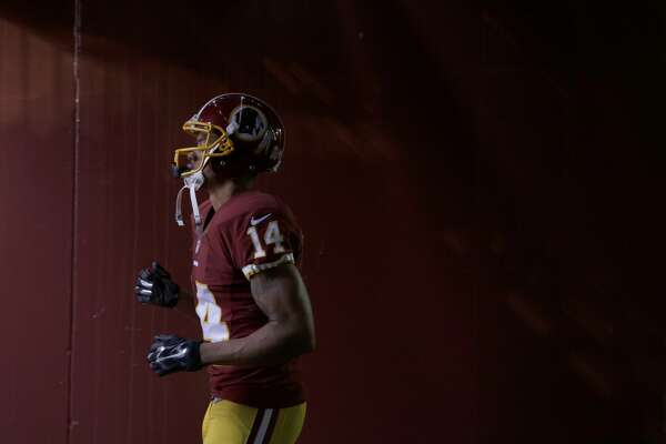 Washington Redskins wide receiver Ryan Grant (14) walks through the tunnel before an NFL football game against the Tampa Bay Buccaneers in Landover, Md., Sunday, Nov. 16, 2014. (AP Photo/Patrick Semansky)