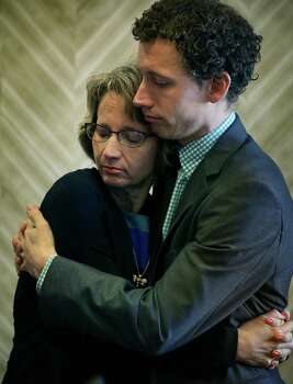 Valerie Redus and her son Kris Redus embrace following a hearing at the John Wood Federal Courthouse in San Antonio.  The parents of Robert Cameron Redus, the slain student at University of the Incarnate Word, were in federal court in San Antonio for a hearing to determine if a lawsuit filed by lawyers of Valerie Redus and Mickey Redus, should stay in federal court or be sent back to state court.  Monday, Nov. 17, 2014. Photo: BOB OWEN, San Antonio Express-News / © 2014 San Antonio Express-News