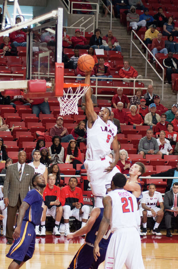 Tyran de Lattibeaudiere (5) of the Lamar University Cardinals, dunks during a matchup against LSU-Alexandria sunday at the Montagne Center. Photograph courtesy of Michael Reed Photo: Michael Reed / Michael Reed