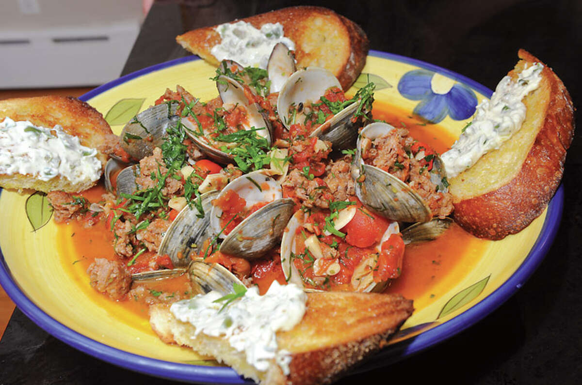 Littleneck Clams with Fennel Sausage, Tomato-Fennel Broth, Grilled Rustic Toast and Green-Olive Aioli made by Chef Courtney Withey in Alplaus, N.Y. Get the recipe here.