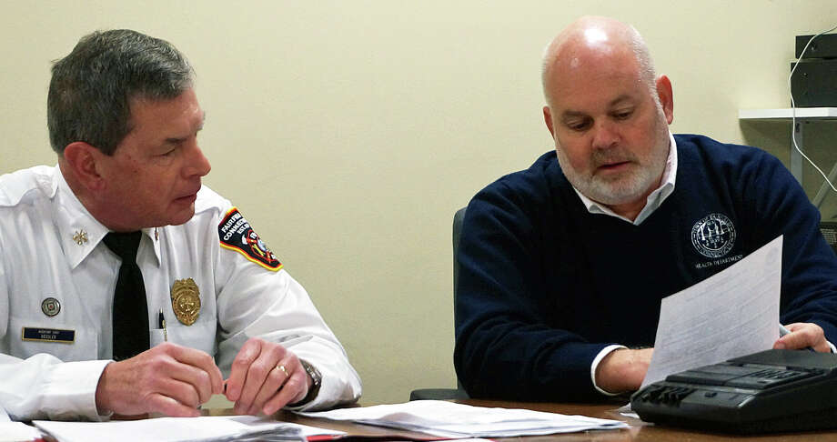 The Condemnation Board agreed Monday that the Plant Factory meets the criteria of a blighted property. Shown here are Fire Marshal William Kessler, chairman of the board, and Health Director Sands Cleary. Photo: Genevieve Reilly / Fairfield Citizen