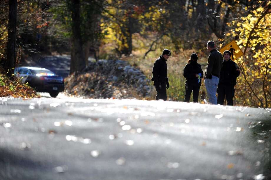 Westport police look for evidence in the suspicious death of a Bridgeport man Saturday, Nov. 15, 2014. A jogger found his body on the side of Partrick Road in Wesport shortly after 9 a.m. Photo: Autumn Driscoll