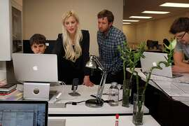 1-Page CEO Joanna Weidenmiller (middle) checks the user interface with designer Peter Hatch (left) and head of customer service Jeremy Malander  (checkered shirt at right) at their office in San Francisco, Calif., on Tuesday, November 11, 2014.