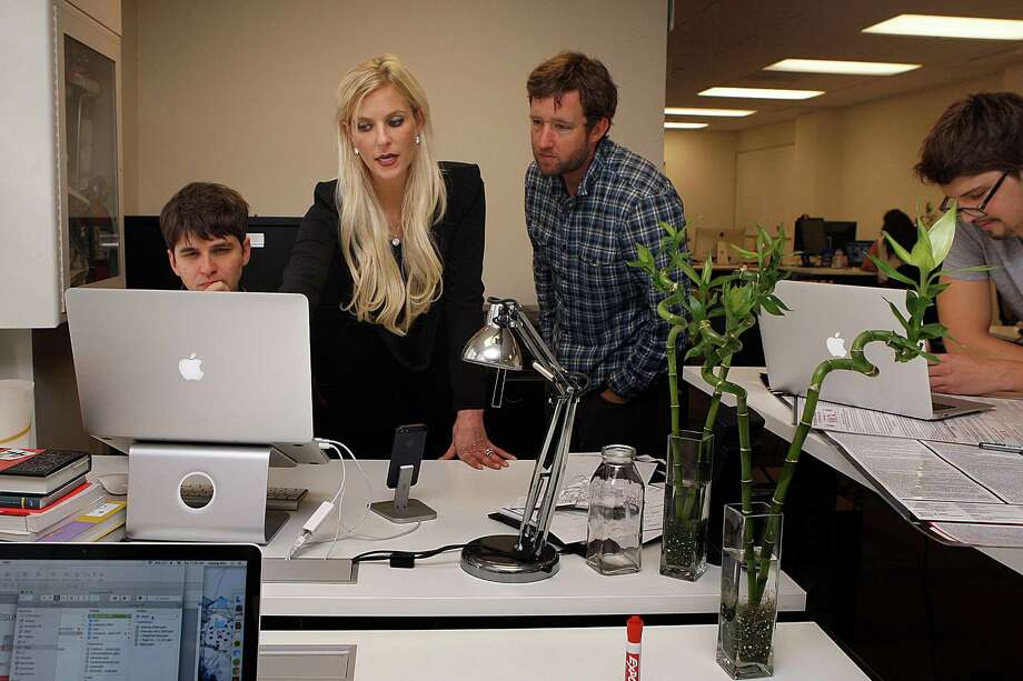 1-Page CEO Joanna Weidenmiller (middle) checks the user interface with designer Peter Hatch (left) and head of customer service Jeremy Malander  (checkered shirt at right) at their office in San Francisco, Calif., on Tuesday, November 11, 2014. Photo: Liz Hafalia / The Chronicle / ONLINE_YES