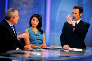 Anchor Veronica De La Cruz and co-anchor Ken Bastida discuss the weather with meteorologist Paul Deanno on the 6pm KPIX 5 newscast at KPIX's Studios on November 11, 2014 in San Francisco, Calif.