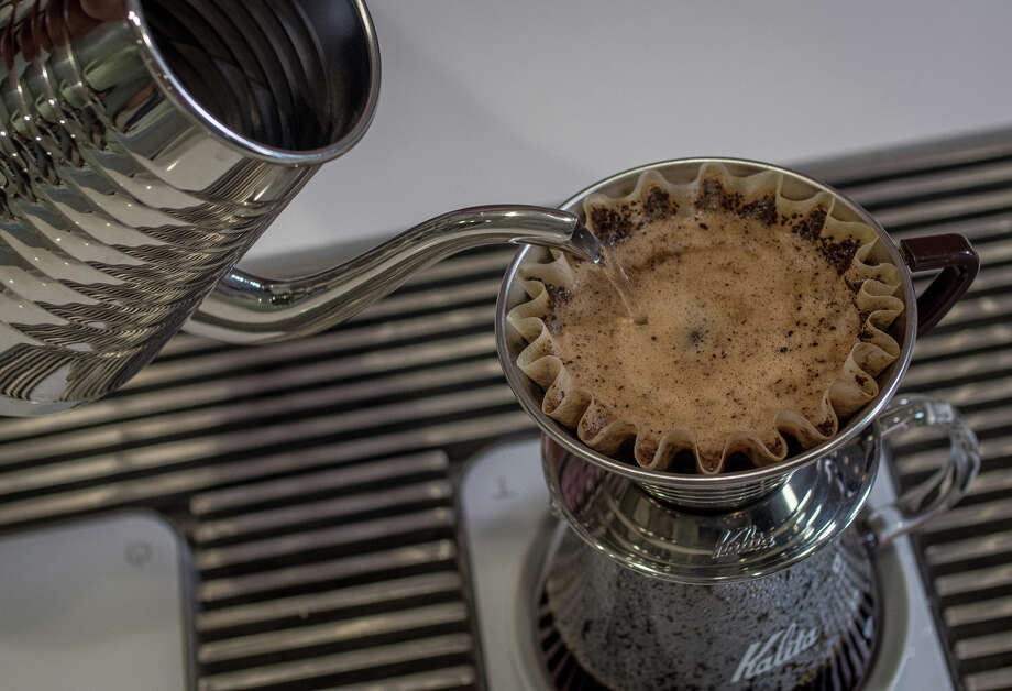Nick Cho creates coffee magic at Wrecking Ball Coffee Roasters in San Francisco. Photo: John Storey / ONLINE_YES