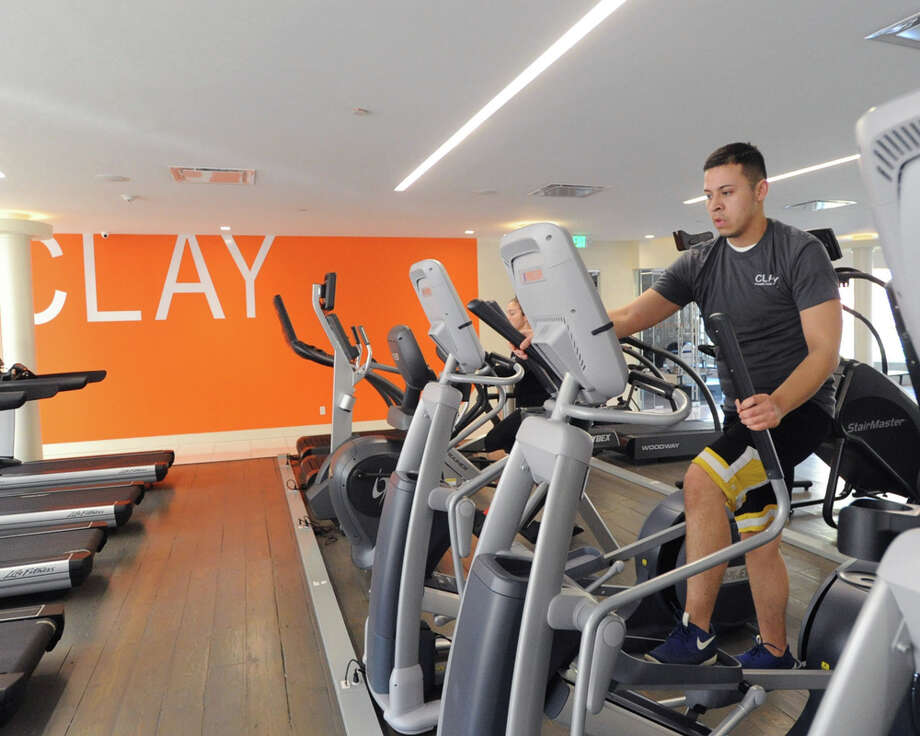 Sergio Michaca demonstrates a state-of-the-art elliptical training machine inside the Clay Health Club + Spa, located at 11 Riverdale Ave., Port Chester, N.Y., Friday, Nov. 14, 2014. Photo: Bob Luckey / Greenwich Time