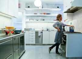 Caitlin Freeman heats up the meringue ingredients for her sweet potato chiffon cake with brown sugar Italian meringue in her home kitchen.